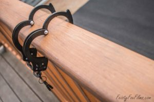 A set of handcuffs hooked over a balcony railing