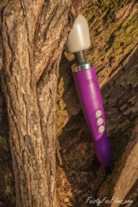 A purple Doxy original nestled in a tree