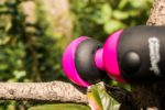 The PalmPower Recharge sits in a tree, the silicone head on the left side of the image, with the cap bending out and away from the rest of the vibrator. This head is on incorrectly.