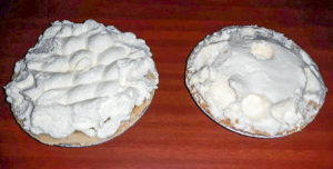 two small pies with whipped cream