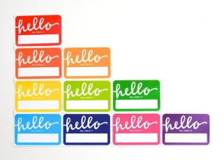 "a rainbow array of stickers saying ""Hello my name is"""
